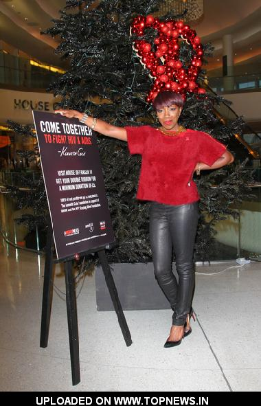 Estelle Switches on the Kenneth Cole Christmas Tree Lights in Support of World AIDS Day at House of Fraser, Westfield in London