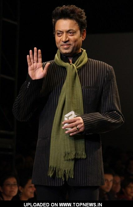 Bollywood actor Irfan Khan displays a creation by designer Meera Ali at the Wills Lifestyle India Fashion week 2012,in New Delhi