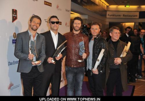 Jason Orange, Robbie Williams, Howard Donald, Gary Barlow and Mark Owen at Echo Awards 2011