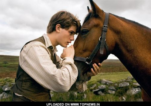 "Albert (Jeremy Irvine) and his horse Joey are featured in this scene from DreamWorks Pictures' ""War Horse"""