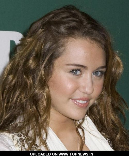 "Miley Cyrus  at Signs Copies of Her New Book ""Miles to Go"" at Barnes & Noble in New York on March 5, 2009"