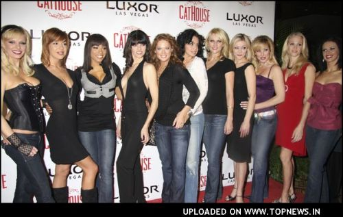 Models at CatHouse Grand Opening Event - Arrivals