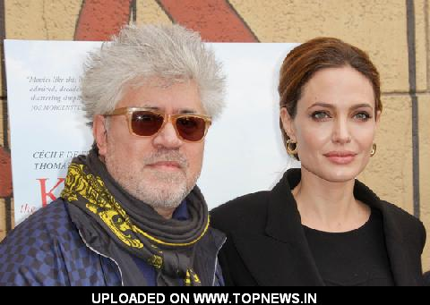 Angelina Jolie and Pedro Almodovar at The American Cinematheque's 69th Annual Golden Globe Awards Foreign-Language Nominee