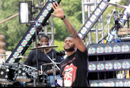 Usher performs on CBS The Early Show at CBS Plaza New York City