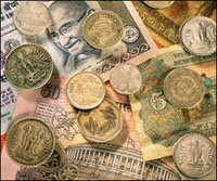 Rupee trades lower compared to US dollar