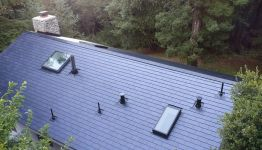 Tesla launches new 'Solar Glass' version of Solar Roof tiles; cost $34,000 for average home