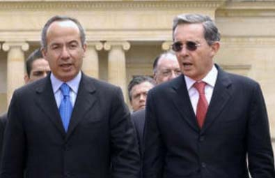 Calderon, Uribe vow active line on economy, tough on crime