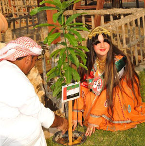 Autistic girl plants trees in Abu Dhabi