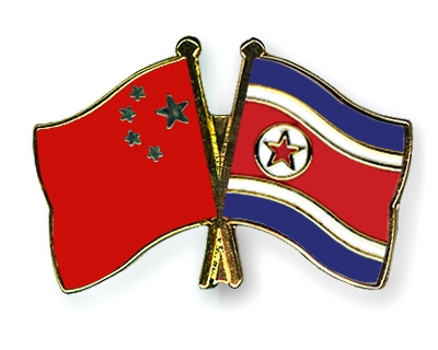 south and north korean flags. China, North Korea seek early