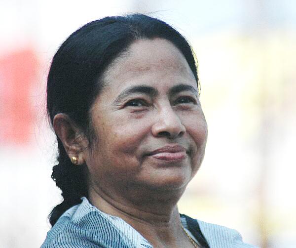 Kolkata, Nov 14 : West Bengal Chief Minister Mamata Banerjee distributed Kali Puja 'prasad' and greeted guests from various parts of the state and abroad as ... - mamata-banerjee01_26