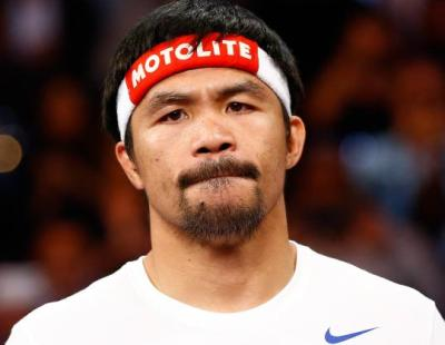 `God is with me,` says under-fire Pacquiao