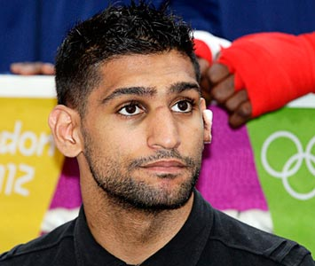 Amir Khan happy to help Olympic gold medallist Nicola Adams turn pro