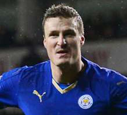 Huth's own goal hands Arsenal 1-0 PL win over Leicester