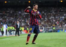 Messi sinks Real Madrid to keep Barcelona in La Liga title race
