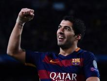 Suarez's brace fuels Barca past Espanyol in La Liga
