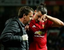 Man U's Ibrahimovic out with knee injury