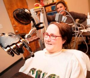 Quadriplegic woman makes medical history with mind-controlled robot arm