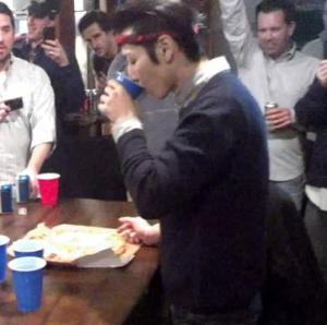 Man downs entire pizza in 60 seconds as Super Bowl stunt