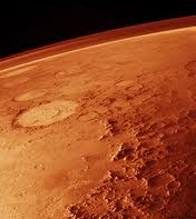 Dust avalanches on the Red Planet triggered by meteorite shockwaves