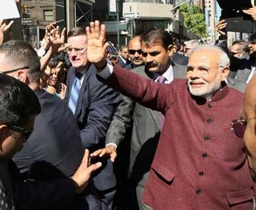 PM Modi interacts with crowd, accepts greetings after landing in U.S.