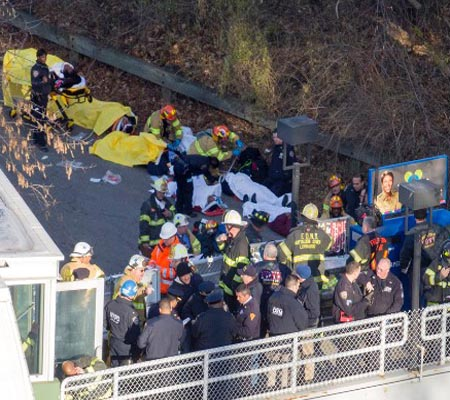 New York train derails killing four, 67 injured