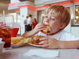 Low-income and more screen time fuel kids' soda and junk food intake