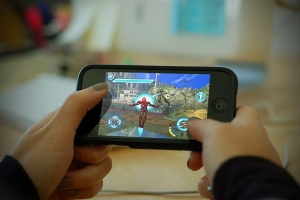 Smartphones encouraging use of social media and computer games