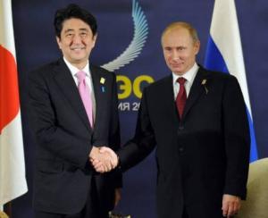 Putin, Abe discuss security ties, disputed islands