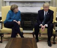 Awkward photo-op: Trump snubs Angela Merkel's request for handshake
